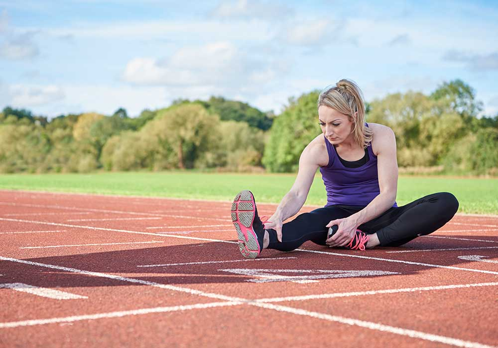 Dani Halsall Running Guide - Dani stretching